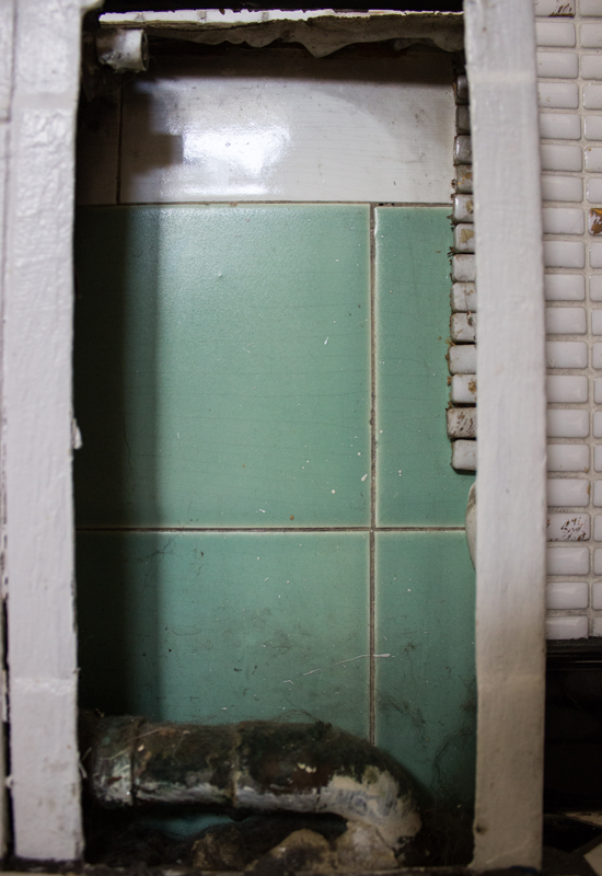 The original kitchen tile can still be found behind the baseboard heaters