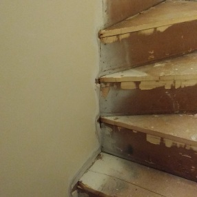 The stairs to the second floor (before). Photo courtesy of Mike and Katrina Morrissey.