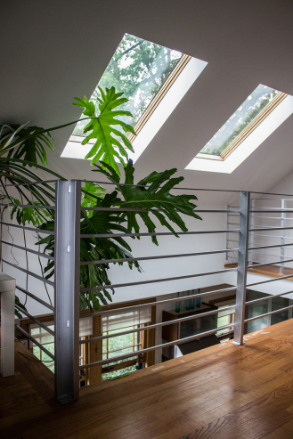 Skylights flood the kitchen and second floor with light